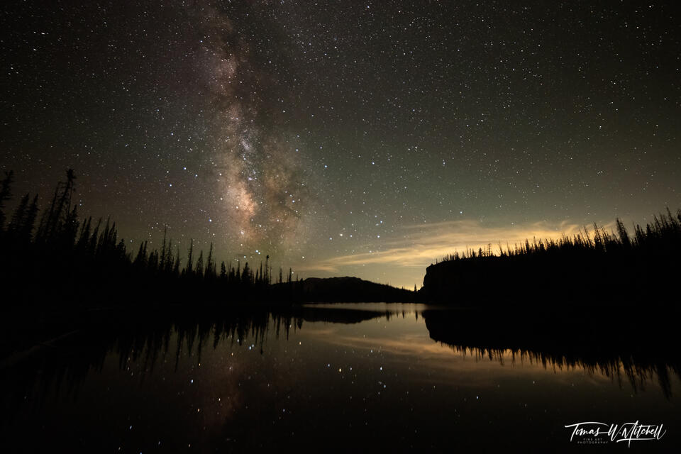 Framed photograph of Milky Way night sky over mountain lake.