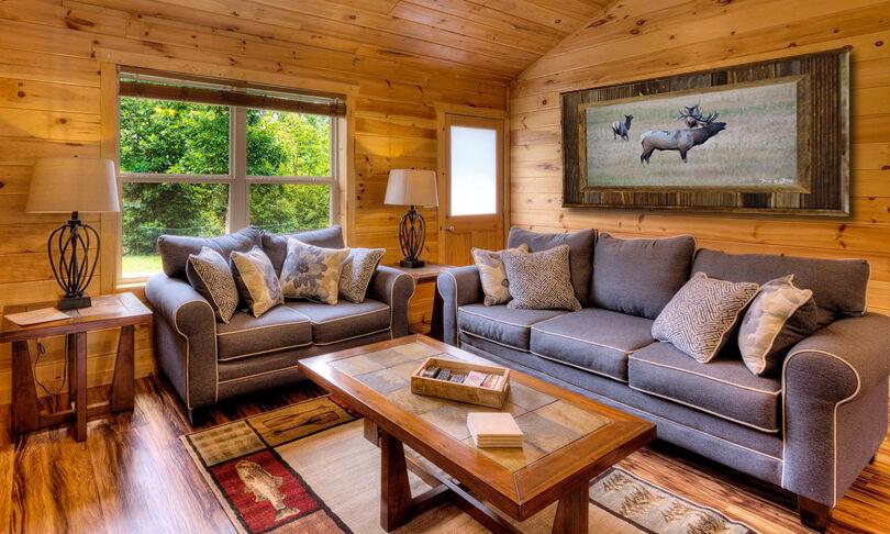 bull elk in wood frame on cabin wall